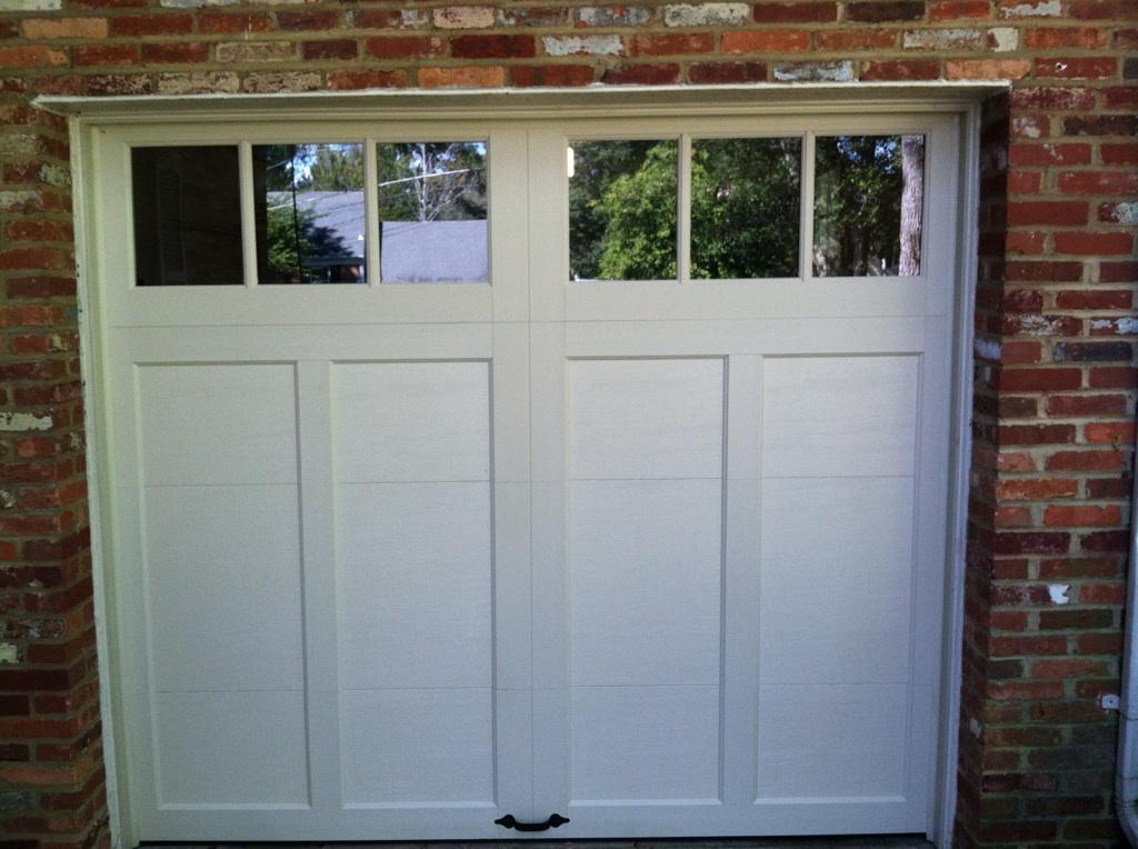 simple clean one car garage affordable door